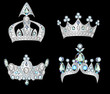 set silver crowns on black background