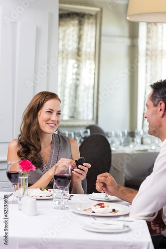 Man proposing a happy woman in the restaurant