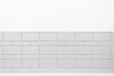 White wall and grey brick