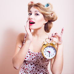 Beautiful happy smiling young pinup woman and clock
