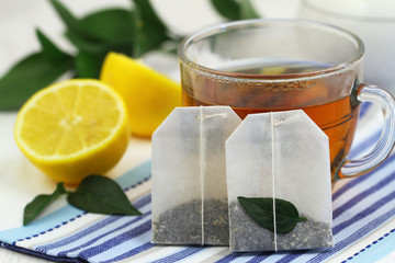 Tea bags, tea and fresh lemon