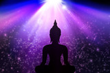 Buddha statue in lights background