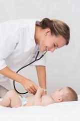 Doctor examining baby boy