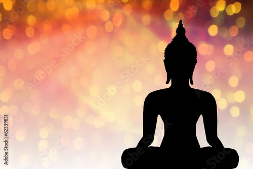 Buddha statue in the neon background