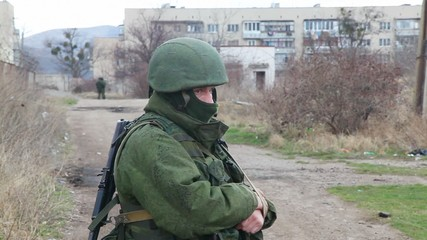 Russian soldier guarding a naval base in Perevalne, Ukraine