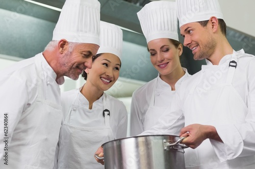 Team of chefs admiring whats in the pot