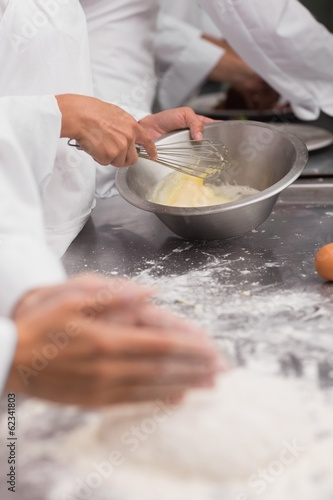 Chef preparing pastry at counter