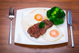 Grilled beef steak with eggs and broccoli