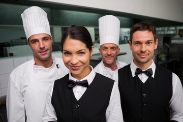 Restaurant team posing together looking at camera