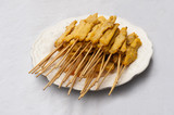 Pork satay on dish isolated on white background.