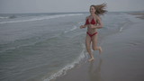 fitness girl running at beach