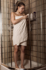 Young woman after a shower in a towel