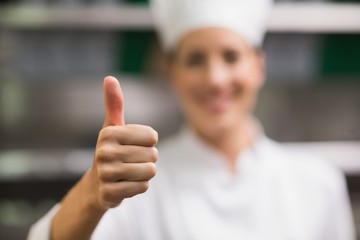 Happy chef smiling at camera giving thumbs up