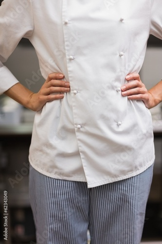 Chef standing with hands on hips