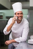 Happy chef talking on the phone