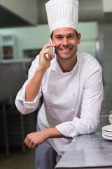 Smiling chef talking on the phone