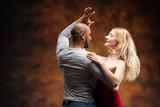 Fototapety Young couple dances Caribbean Salsa