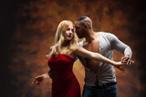Fototapety Young couple dances Caribbean Salsa