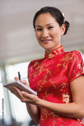 Waitress in kimono taking an order