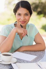 Smiling businesswoman having coffee and planning her week