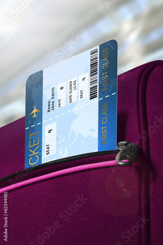 fly ticket in pocket of rouge suitcase