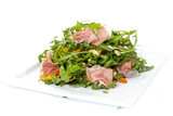 salad of arugula ham cheese on a white background