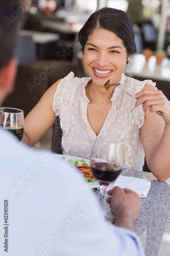 Happy woman smiling at her date