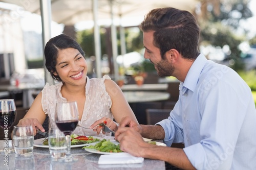 Happy couple on a date having lunch