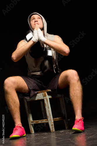 Young boxer praying for a victory