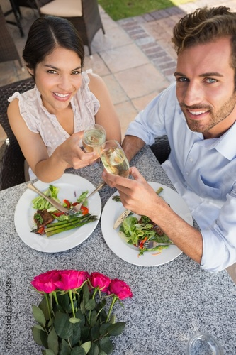 Happy couple celebrating their anniversary with champagne