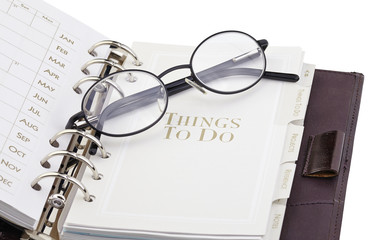 """eyerglasses on the page """"what to do"""" of the personal organizer"""