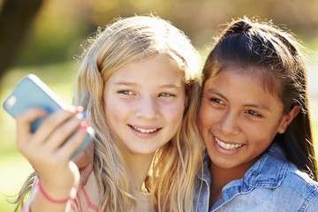 Two Girls Taking Selfie With Mobile Phone