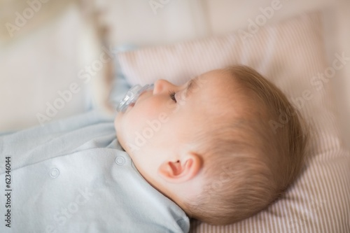 Baby boy sleeping in crib