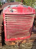 Antique broken down tractor radiator grill.