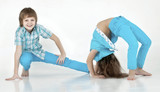 boy and girl doing gymnastics on white background