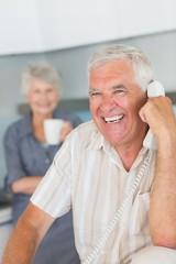 Happy senior man on the phone