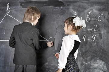 boy and girl writing on blackboard
