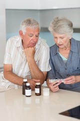 Senior couple looking at their medicine