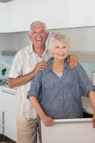 Happy senior couple smiling at the camera