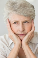 Depressed senior woman looking away