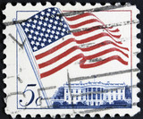 Postage stamp printed in the USA, shows the national flag