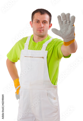 young man wearing working clothes isolated on white background