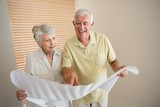 Senior couple looking at houses blueprints together