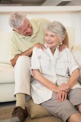 Senior man giving his partner a shoulder massage