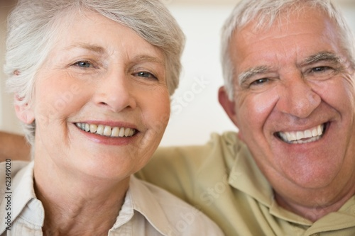 Senior couple smiling at the camera together
