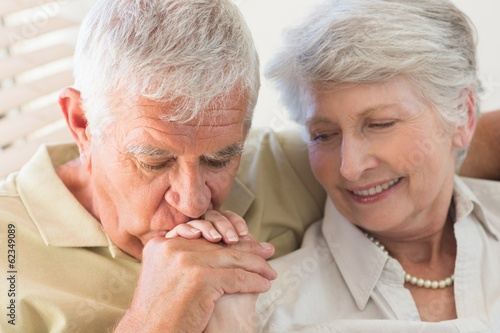 Senior couple holding hands