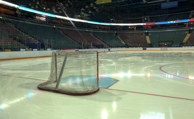 empty ice hockey playground - the view from behind the gate