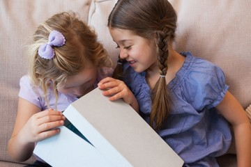 Close-up of two young girls with gift box