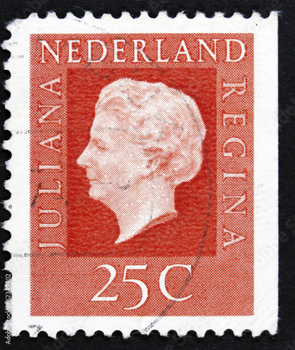 Stamp printed in Netherlands shows portrait of Queen.