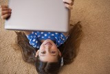 High angle view of a little girl using digital tablet